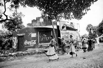 International Women's Day. The real one -- Miles of walk every single day to get water to drink and cook because Coke has took their traditional water sources. (Film star Amir Khan would not disclose it in his Coke promo. Neither would Sonia Gandhi).