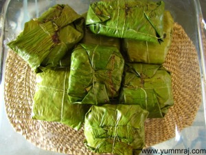 Steamed fish wrapped in banana leaf.