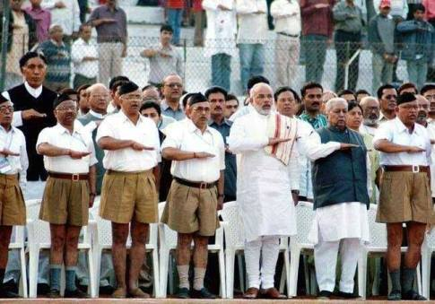 Prime Minister Modi praying at RSS meeting. U.S. once revoked his visa, but that was before he became a friend of Obama, Clinton, and Wall Street.